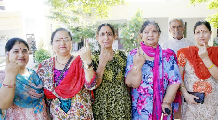Migrant voters at a polling booth in Jammu after casting their vote on Monday. -Excelsior/Rakesh