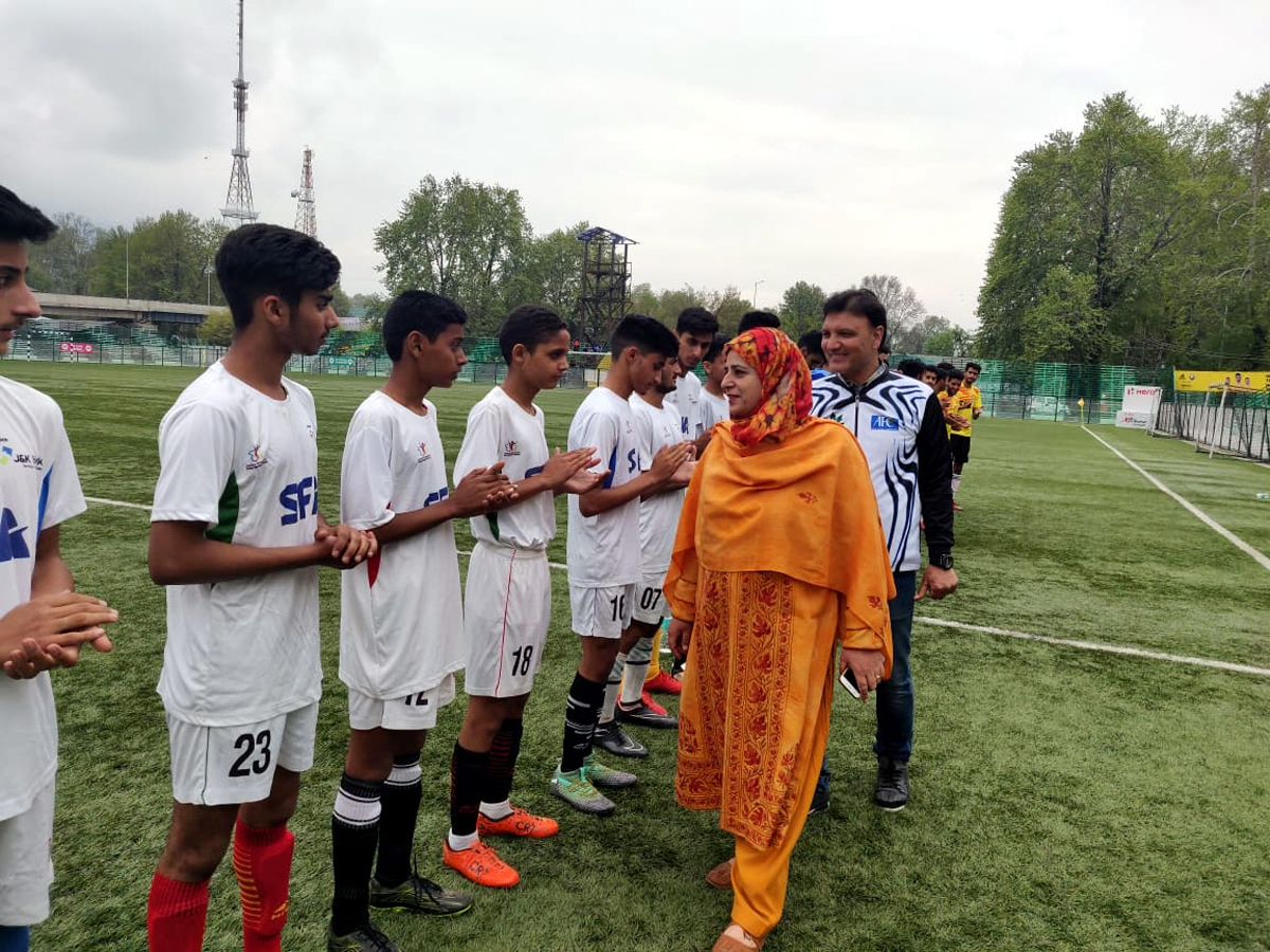 Chief guest interacting with players during a match of final phase of Youth Football League in Srinagar.
