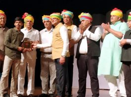 A student being presented a prize during a function organised in connection with celebration of Mahavir Jayanti at Jammu on Wednesday.
