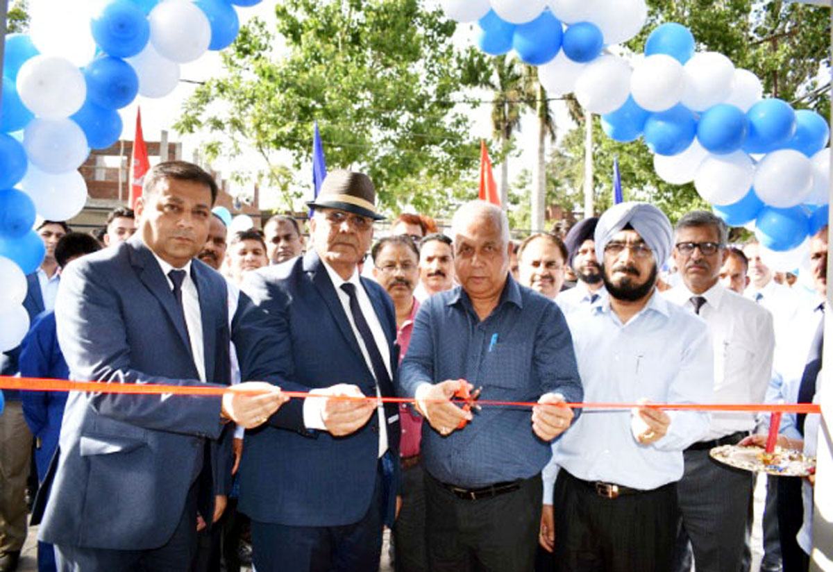 Kapil Choudhary, Branch Head, J&K Bank Muthi, Col Rattan Singh, CEO Jamkash Vehicleades Private Limited and others inaugurating workshop at Muthi on Monday.