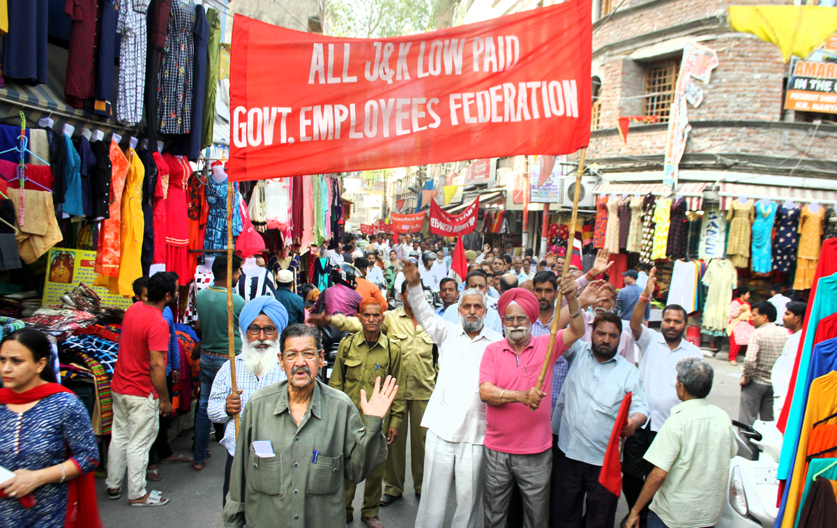 Low paid Govt employees taking out May Day rally in Jammu on Monday. -Excelsior/Rakesh