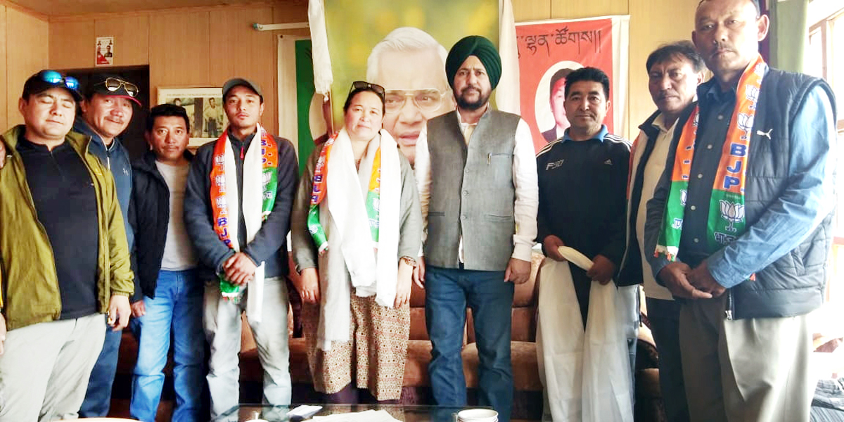 BJP State general secretary, Dr Narinder Singh posing with party activists during a meeting at Leh on Monday.