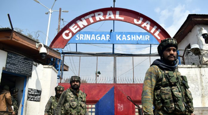 Para-military personnel guard the Central Jail Srinagar following clashes. —Excelsior/Shakeel