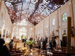 Crime scene officials inspect the site of a bomb blast inside a Church in Negombo, Sri Lanka on Sunday.