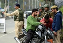 Security forces conducting frisking at Maulana Azad road on Sunday. (UNI)