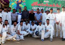 Players posing for group photograph with dignitaries at Jammu on Wednesday.