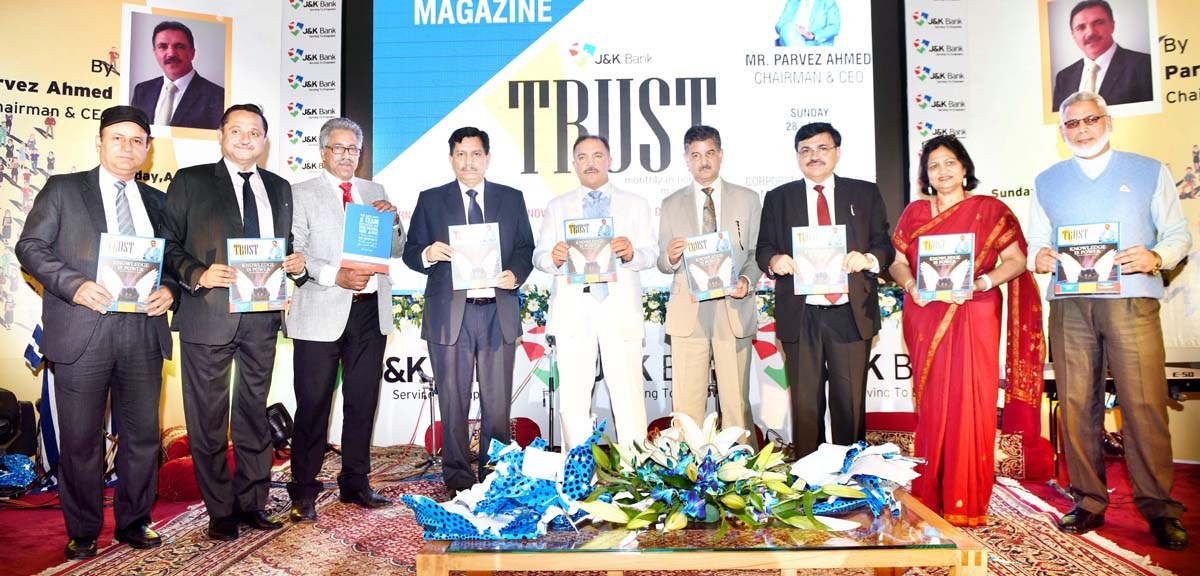 JK Bank Chairman Parvez Ahmed and others releasing first issue of 'TRUST' on Monday.