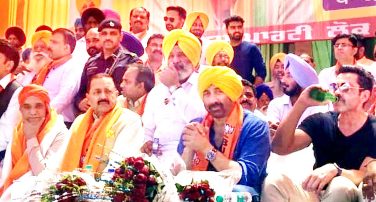 Union Minister Dr Jitendra Singh, BJP candidate Sunny Deol and cine actor Bobby Deol at a public rally at Gurdaspur, after the filing of nomination papers on Monday.