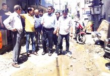 JMC Mayor, Chander Mohan Gupta along with others during a tour of Bakshi Nagar area in Jammu on Monday.