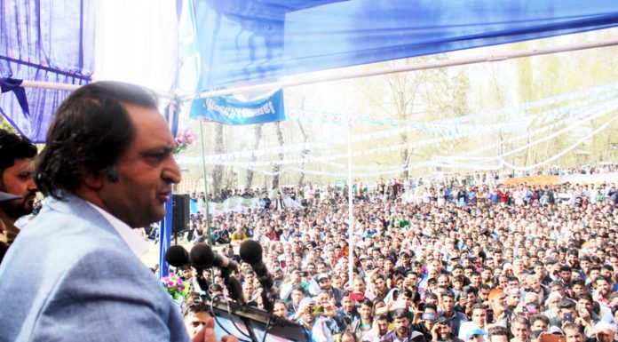 People's Conference patron Sajad Lone addressing a rally at Hanjiwara Pattan in Baramulla on Sunday. -Excelsior/Aabid Nabi