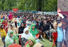 National Conference president Dr Farooq Abdullah waiving to the crowd during a rally at Sher-e-Kashmir Park in Srinagar on Monday. -Excelsior/Shakeel