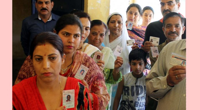 Kashmiri migrants in a queue at polling station Barnai to cast their vote on Tuesday. -Excelsior/Rakesh