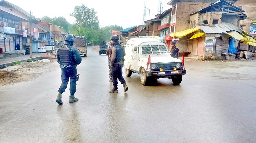 Security personnel at the site of gun battle at Bijbehara, Anantnag on Thursday. -Excelsior/Sajad Dar