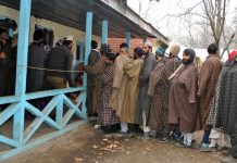 People queue up to cast votes in Anantnag town on Tuesday. — Excelsior/Sajad Dar