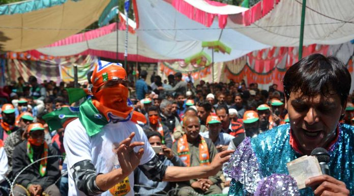 People singing and dancing during the rally of BJP leader Ram Madhav at Khanabal on Saturday. —Excelsior/Sajad Dar