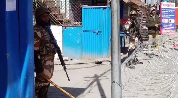 Troops guard curfew bound Kishtwar town on Wednesday.