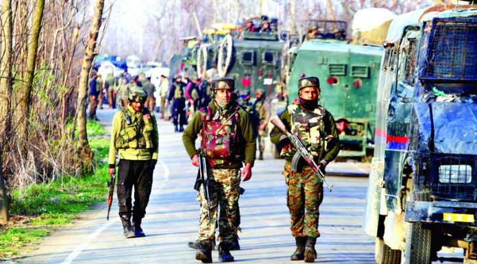 Troops at the site of encounter at Lassipora, Pulwama on Monday.-Excelsior/Younis Khaliq