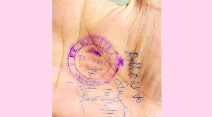 A civilian granted permission to drive from home to office on the Kashmir highway by stamping on hand.