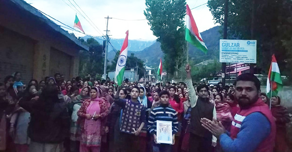 People holding protest in Kishtwar town against the killings of RSS leader on Wednesday.