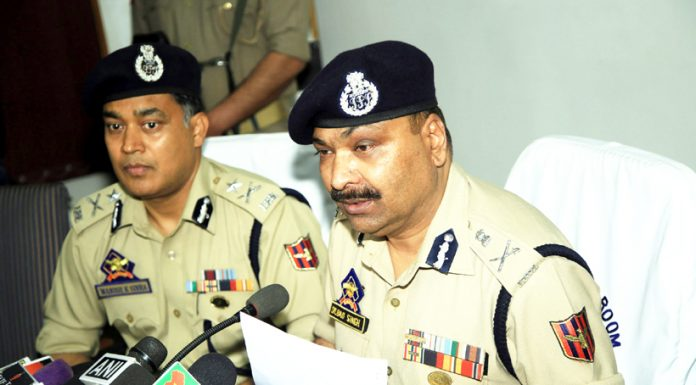 DGP Dilbag Singh and IGP M K Sinha addressing a press conference in Jammu on Monday. -Excelsior/Rakesh