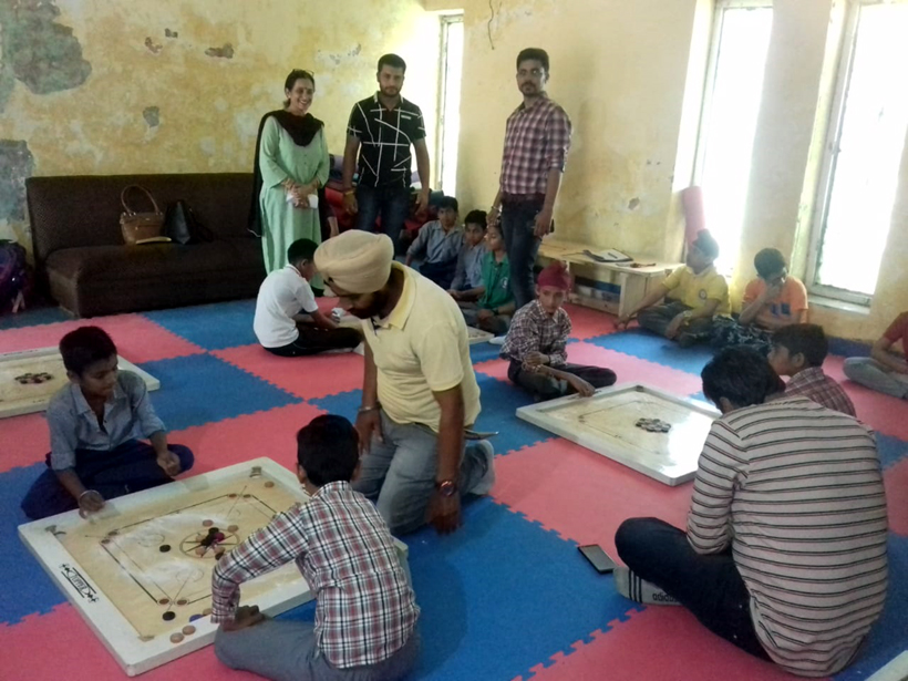 Players in action during Carrom competitions organised by DYSSO Jammu in Jammu.