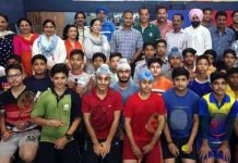 Students posing along with chief guest and other dignitaries during inaugural ceremony of District Level Inter School competitions in Jammu.