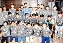 Young footballers posing along with Secretary J&K State Sports Council in Jammu before leaving for Gurgaon.