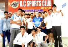 Young cricketers posing along with Coach Rodney Jones at KCSC in Jammu on Friday.