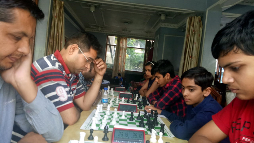 Players in action in Jammu division Chess selection events on Tuesday.