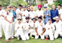 Teams posing along with organisers and officials at Country Cricket Stadium, Gharota in Jammu.