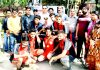 Winners of 4th Fazil Abbas Volleyball Tourney posing for a group photograph along with dignitaries and officials in Jammu on Monday.