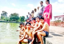 Swimmers posing along with dignitaries and officials during inter-school competitions in Samba.