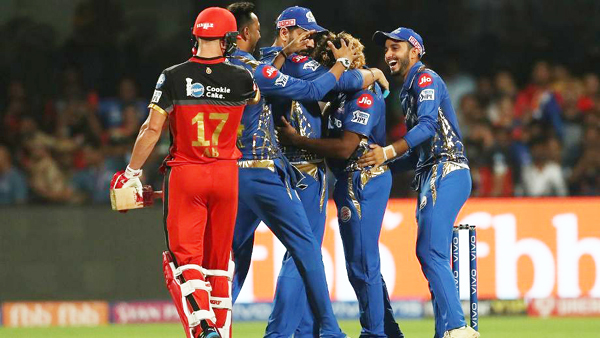 Mumbai Indians players celebrating dismissal of RCB's AB de Villiers in IPL 2019 at Hyderabad.