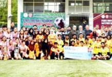 Young footballers posing along with special guest at TRC Turf in Srinagar on Thursday.