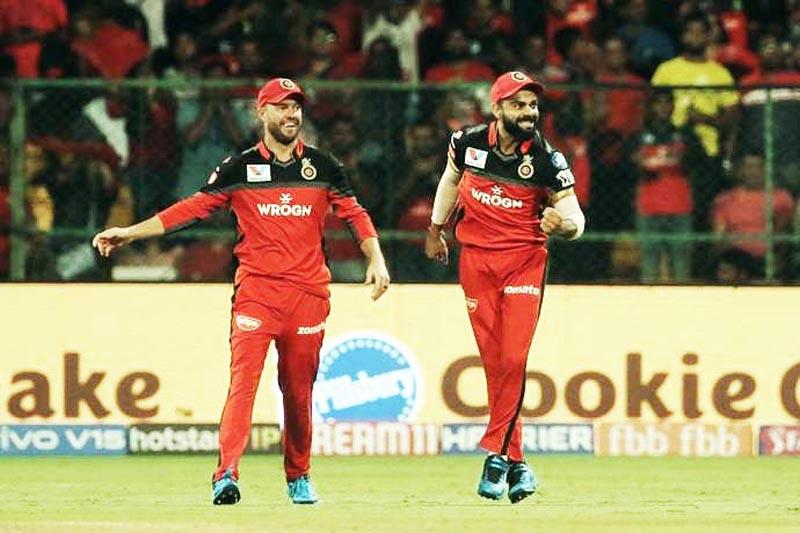 RCB skipper Virat Kohli and his team mate AB De Villars enjoying victory against Kings XI Punjab in IPL 2019 at Bengaluru.