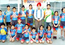 Medal winning skaters posing along with President, J&K Skating Association, GS Khurmi and other dignitaries in Jammu.