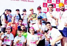 jrg members posing for a group photograph after excelling in 3rd Edition of Amritsar Half Marathon.
