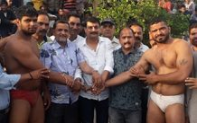 Wrestlers being honoured by dignitaries on Monday.