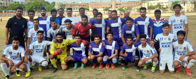 Teams posing with special guest and officials at Mini Football Stadium, Parade in Jammu on Tuesday.