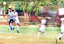 Players in action during a match of Arun Kumar Memorial Gold Cup Football tournament in Jammu on Thursday.
