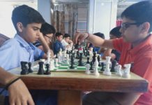 Players in action during Chess competition in Jammu on Monday.