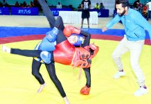 Players in action during 15th J&K State Wushu Championship in Jammu.