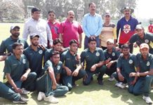 Jubilant Martyr Raj Tilak XI players posing alongwith chief guest and other dignitaries in Jammu on Monday.