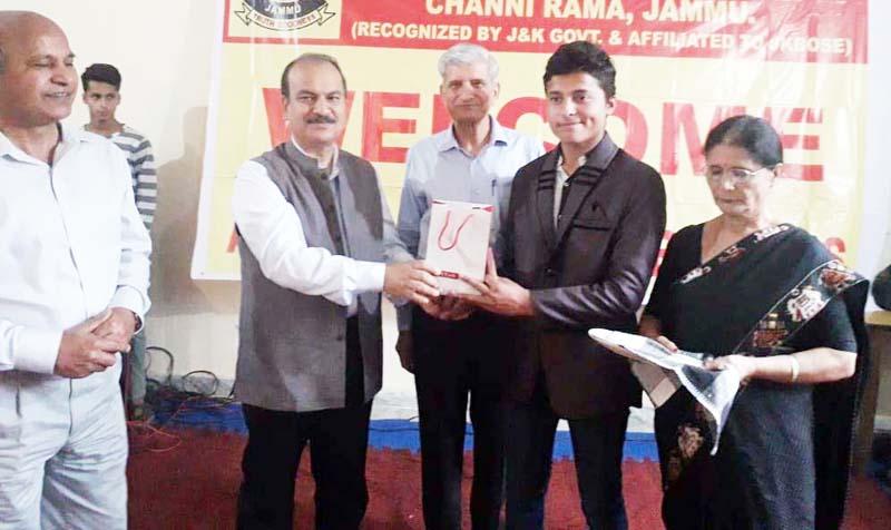 VC JU, Prof Manoj K. Dhar awarding a meritorious student of Balgran on Wednesday.