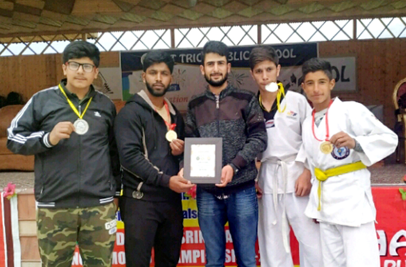 Medal winners of Tiger Martial Art Club posing for a group photograph in Srinagar.