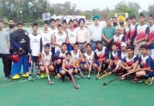 Young Hockey players posing alongwith organisers and officials at KK Hakhu Stadium in Jammu on Wednesday.