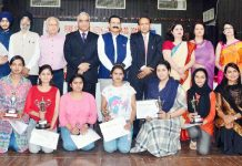 Winners of Essay, poster making competition posing alongwith Chief guest and other dignitaries on Saturday.