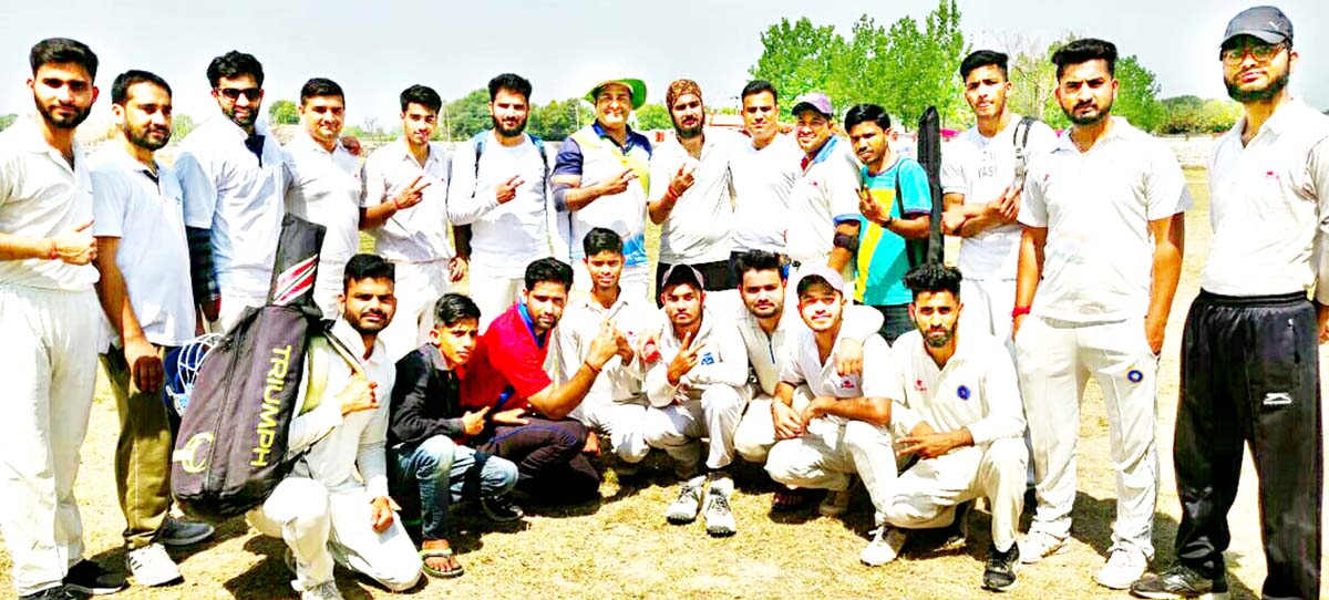 Players of SKCC team posing for a group photograph after registering win in exhibition cricket match.