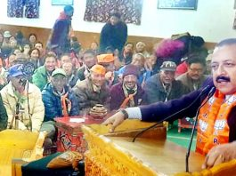 Union Minister Dr Jitendra Singh addressing a BJP election meeting at Leh .