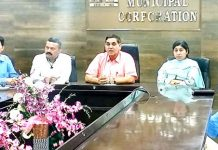 JMC Mayor chairing a meeting on Tuesday.